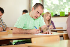 Handsome student in a classroom Stock Photography