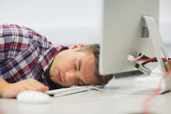 Handsome student dozing in the computer room Stock Image