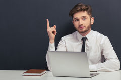 Handsome student with gadget Royalty Free Stock Image