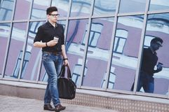 Handsome student going to an internship in the office royalty free stock images