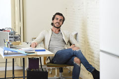 Handsome student or hipster trendy style businessman wearing battered denim jeans posing corporate Stock Image
