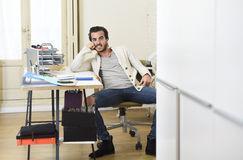 Handsome student or hipster trendy style businessman wearing battered denim jeans posing corporate Stock Images