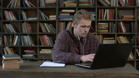 Handsome student with laptop e learning at home stock footage