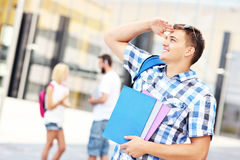 Handsome student looking to the left in the campus Stock Images