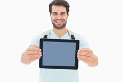 Handsome student showing his tablet pc. On white background Royalty Free Stock Photos