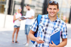 Handsome student with smartphone Royalty Free Stock Photos