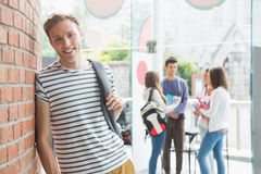Handsome student smiling at camera Royalty Free Stock Image