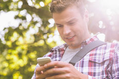 Handsome student standing and texting Stock Photos
