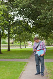 Handsome student standing and texting Royalty Free Stock Photography