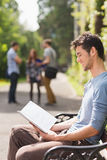 Handsome student studying outside on campus. At the university Stock Photo