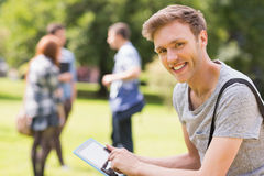 Handsome student studying outside on campus Stock Photography