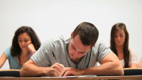 Handsome student taking notes Stock Photography