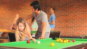 Handsome student teaching pool Stock Photo