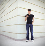 Handsome student using a mobile phone Stock Photos