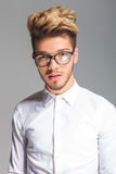 Handsome student wearing frames while posing in studio Royalty Free Stock Photo