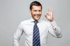 Handsome stylish businessman on grey background Stock Images