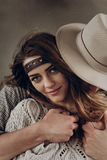 Handsome stylish cowboy man in hat and shirt embracing beautiful. Handsome stylish cowboy men in hat and shirt embracing beautiful gypsu women from behind Stock Photography