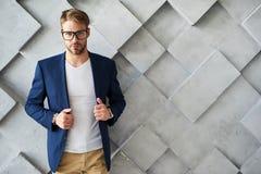 Handsome stylish male holding jacket stock photos