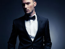 Handsome stylish man. Portrait of handsome stylish man in elegant black suit Stock Photography