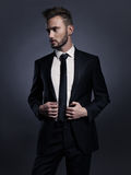 Handsome stylish man in black suit Stock Image