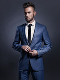 Handsome stylish man in blue suit Royalty Free Stock Image