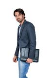 Handsome stylish man carrying a briefcase Stock Photos