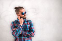 Handsome stylish man is standing near wall. royalty free stock photography