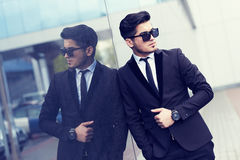 Handsome stylish man in elegant black suit and sunglasses Royalty Free Stock Photography
