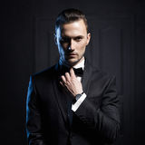 Handsome stylish man. Portrait of handsome stylish man in elegant black suit Royalty Free Stock Image