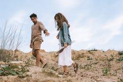 Handsome stylish man walking with beautiful girlfriend stock image