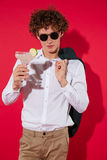 Handsome stylish man in white shirt and jacket holding cocktail Royalty Free Stock Photos
