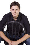 Handsome and stylish model sitting on chair Stock Image