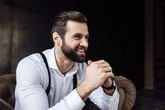 handsome stylish smiling man sitting royalty free stock photos