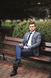 Handsome stylish young businessman posing portrait outdoor.  Stock Photos