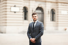 Handsome stylish young businessman posing portrait outdoor.  Stock Photo