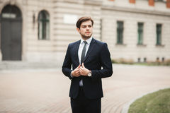 Handsome stylish young businessman posing portrait outdoor.  Royalty Free Stock Photo