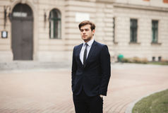 Handsome stylish young businessman posing portrait outdoor.  Royalty Free Stock Images