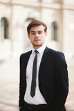Handsome stylish young businessman posing portrait outdoor.  Royalty Free Stock Photos