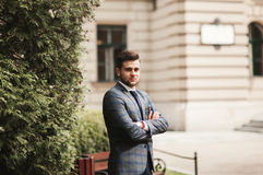 Handsome stylish young businessman posing portrait outdoor.  Stock Image