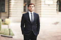 Handsome stylish young businessman posing portrait outdoor.  Royalty Free Stock Image