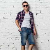Handsome stylish young man in jeans shorts and Stock Photos