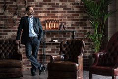 Handsome successful businessman standing in his study room Royalty Free Stock Photo