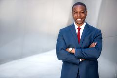Handsome successful cheerful african american executive business man in modern stylish suit, CEO, copy space