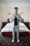 Handsome successful confident man in a posh classic room Royalty Free Stock Images