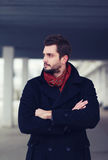 Handsome successful man stands hands crossed and looking away stock photos