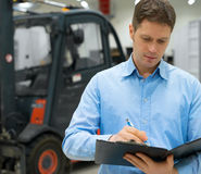 Handsome supervisor. Handsome supervisor with clipboard at warehouse Stock Photography