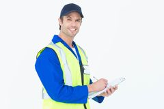 Handsome supervisor writing notes on clipboard Stock Photo
