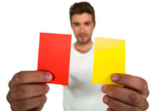 Handsome supporter showing red and yellow cards Stock Photo