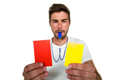Handsome supporter showing red and yellow cards Royalty Free Stock Images