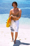 Handsome surfer. Holding a surf board stock photo